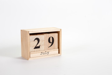 Wooden calendar July 29 on a white background