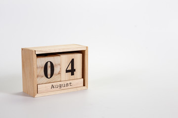 Wooden calendar August 04 on a white background