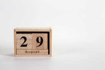 Wooden calendar August 29 on a white background