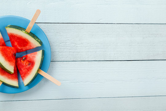 Cold watermelon popsicles on a plate