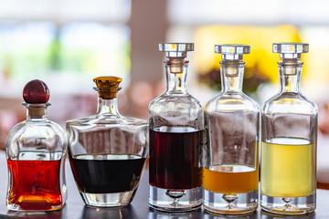 Fototapeta Set of bottles with home made tasty liqueurs inside. obraz