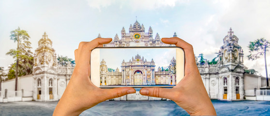 Tourist taking a picture in front of   Dolmabahce Palace Istanbul, Turkey. Travel concept