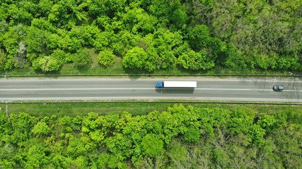 Canvas Prints Pistachio Wagon driving on the highway, aerial. Transport logistics background top view.