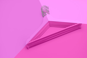 Creative fashion concept. Flat lay top view colored wooden hangers on pink background minimalism style pop-art. Sale discount store shopping concept, design empty hanger. Beauty feminine blog