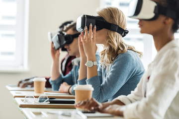 Group of people using VR headsets