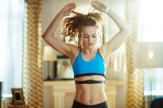 fit sports woman workout and using heart rate monitor