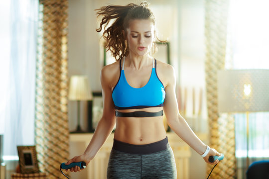 active woman exercise using jump rope with heart rate monitor