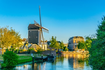sunset view of windmill de Put in Leiden, Netherlands Wall mural