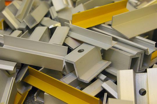 Various aluminum profiles are in bulk. Industry