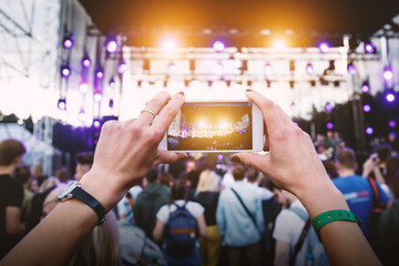 Using a mobile phone at outdoor music festival
