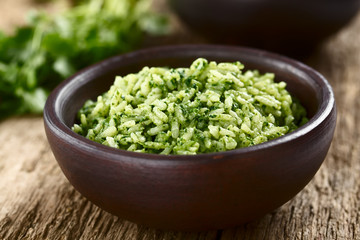 Traditional Mexican Arroz Verde green rice dish made of long-grain rice, spinach, cilantro and...