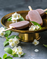 Homemade vanilla ice cream with chocolate glaze.