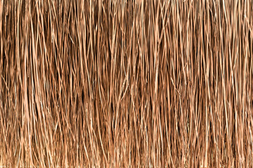 Fototapeta Thatched roof or wall background. Tropical roofing on beach obraz