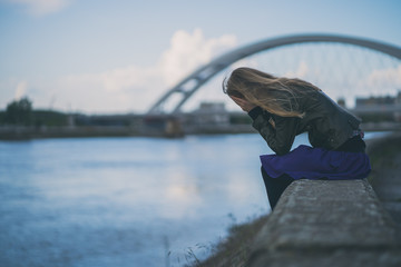 Lonely and depressed woman sitting in grief.