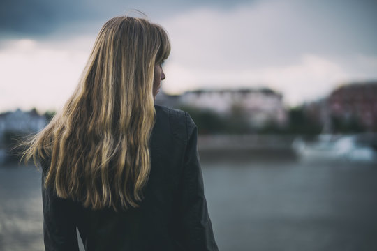 Portrait of lonely and pensive woman who is looking at distance.