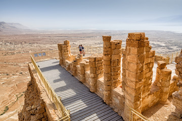 Couple at the ancient fortification Masada in Israel. Masada National Park in the Dead Sea region of Israel.