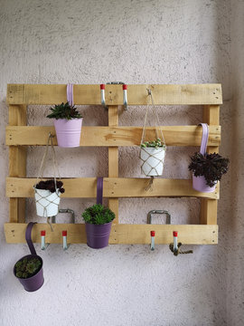 wooden pallet as decoration on a balcony wall