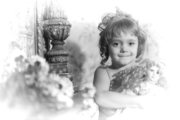 portrait of a little girl with a retro doll in her hands