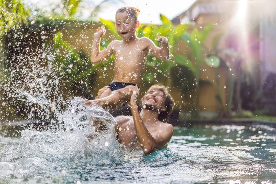 Dad and son have fun in the pool