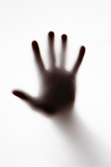 shillouette of a persons hand on a white background, abstract nightmare concepts - fototapety na wymiar