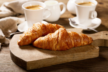 breakfast with cups of coffee and croissants