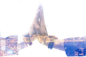 Double exposure of Man hand assembly high five for good teamwork,Business success Team in the city image concept