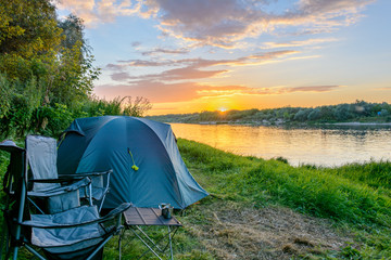 Foto auf AluDibond Camping Tourism equipment. Camping tent, tourist chairs in camping by the river