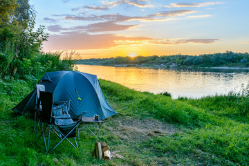 Foto auf AluDibond Camping Camping tent in a camping in forest by the river