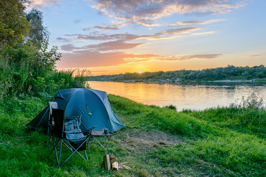 Camping tent in a camping in forest by the river