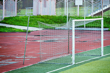 Football gate on the old empty stadium.