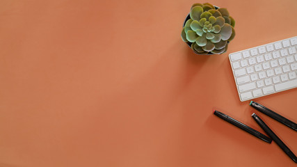 Minimal workspace and office supplies on pastel top table background