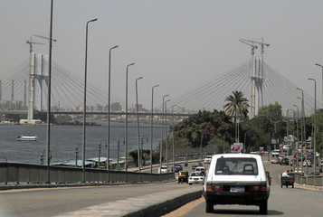 "Cars are driven towards the new suspension bridge crossing the River Nile and named the ""Long Live Egypt"" bridge, part of Rawd al-Faraj Axis project near Cairo's Warraq Island"