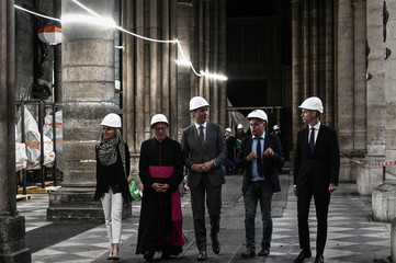 Canadian Ambassador to France Isabelle Hudon, Monseigneur Patrick Chauvet, Canadian Prime Minister Justin Trudeau, French Chief Architect, Philippe Villeneuve and French Culture Minister Franck Riester visit the Notre-Dame Cathedral in Paris