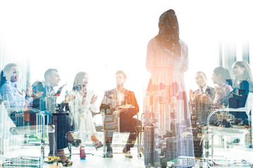 Double exposure city background.Muslim woman speaks in office.Business, startup, presentation, strategy and people concept - men making presentation to creative team at office.