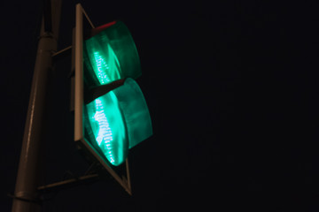 Traffic light with green light and safe to move.