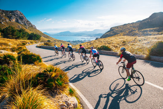 Team sport cyclist photo. Group of triathlete on bicycle ride on the road at Mallorca, Majorca, Spain.