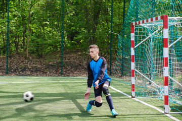 Goalkeeper catches the ball. Stadium goalie sports play ground game, grass soccer keeper man, outdoorsc ompetition,
