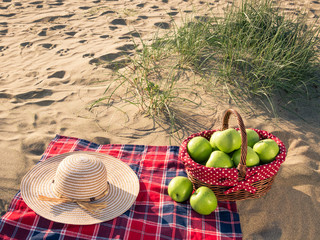 a picnic with picnic basket at the beach on holiday
