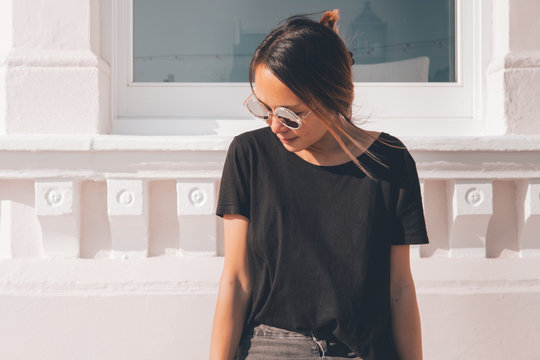 Asian woman wearing sunglasses on a sunny day