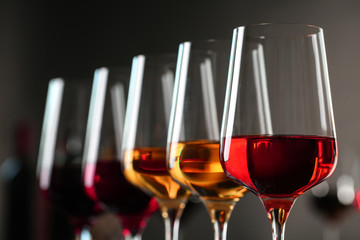 Spoed Foto op Canvas Alcohol Row of glasses with different wines against blurred background, closeup