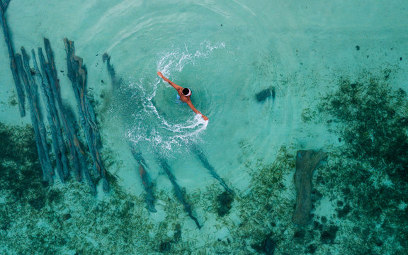 aerial view photography of person swimming during daytime