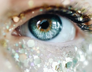 close-up photography of human eye with glitters