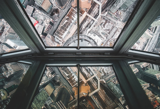 cityscape far below panes
