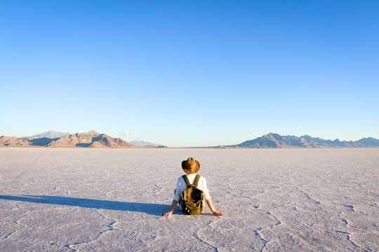 man sitting in front of desert
