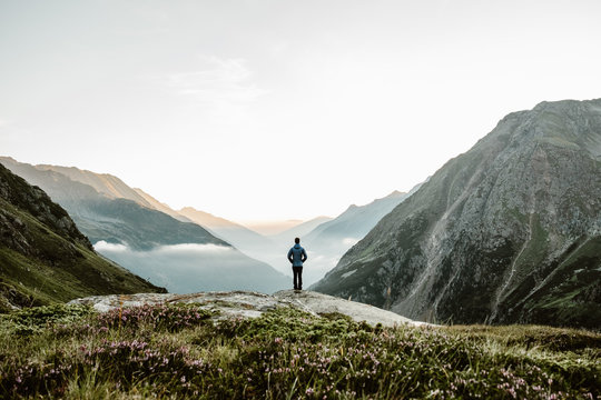 person standing on mountain during daytime