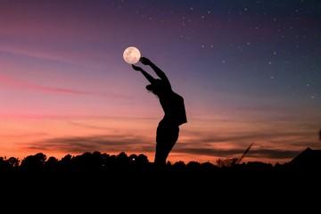 silhouette of woman raising her hand