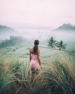 woman standing on green grasses