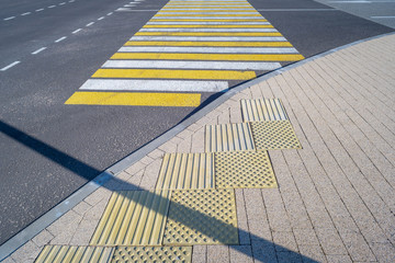 Open space with road signs and road markings, road intersections, pedestrian crossings, sunny day,...