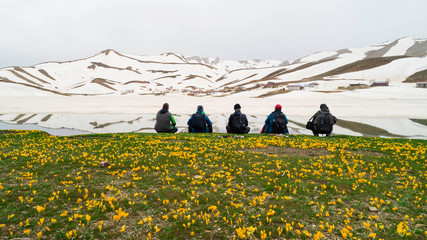 travelers watching snowy mountains