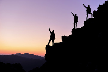 successful people on the peaks of mountains